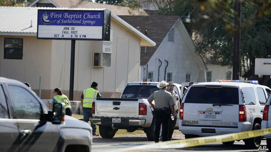 Law enforcement officers gather in front of the First Baptist Church of Sutherland Springs after a fatal shooting, Nov. 5, 2017, in Sutherland Springs, Texas.