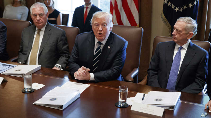 President Donald Trump speaks during a cabinet meeting at the White House as Secretary of State Rex Tillerson, left, and Secretary of Defense Jim Mattis, right, listen, Oct. 16, 2017.
