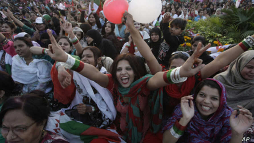 Women supporters of Muttahida Qaumi Movement take part in rally titled 'Empowered Women, Strong Pakistan', Sunday, Feb. 19, 2012 in Karachi, Pakistan.