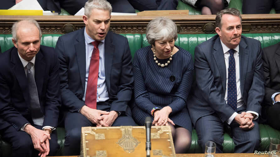 Britain's Prime Minister Theresa May reacts during the debate on extending Brexit negotiating period in Parliament in London, Britain, March 14, 2019.