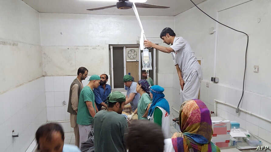 In this photograph released by Medecins Sans Frontieres (MSF) on October 3, 2015, fires burn in part of the MSF hospital in the Afghan city of Kunduz after it was hit by an air strike.