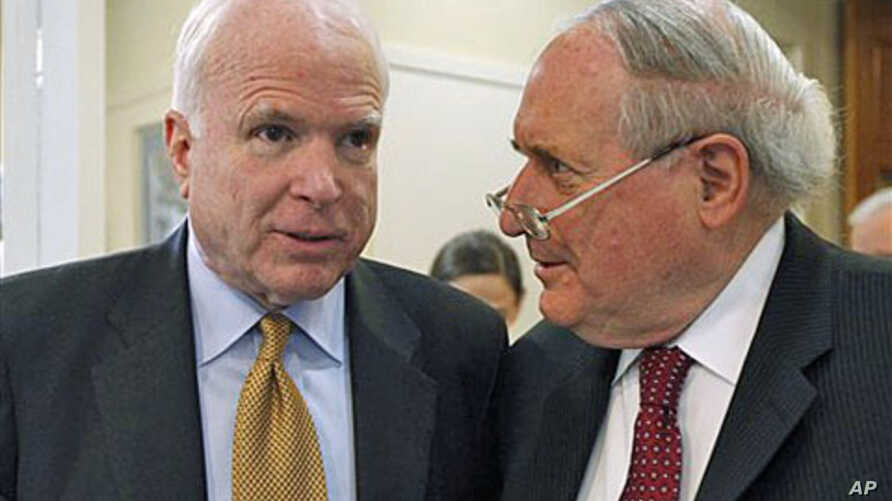 Sen. Carl Levin (R) and Senator John McCain talk about the Chinese government's failure to cooperate in an ongoing Senate Armed Services Committee investigation into counterfeit parts in the Defense Department supply chain, on Capitol Hill in Washing