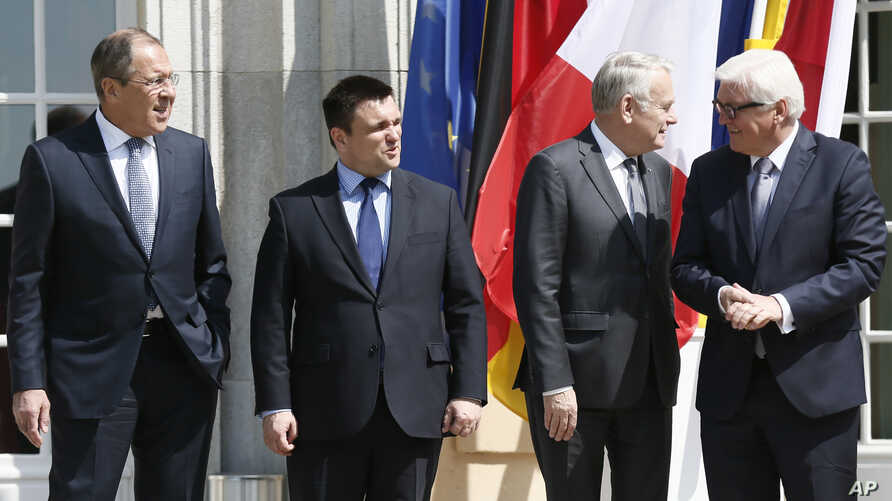 FILE - From left, Russia Foreign Minister Sergei Lavrov, Ukraine Foreign Minister Pavlo Klimkin, France Foreign Minister Jean-Marc Ayrault and German Foreign Minister Frank-Walter Steinmeier gather before talks in Berlin, Germany, May 11, 2016.