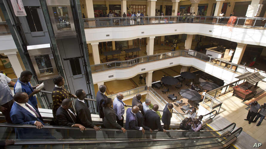 Kenyan dignitaries take a tour of the Westgate Mall, during a viewing for the media prior to it being re-opened to the public, in Nairobi, July 14, 2015.