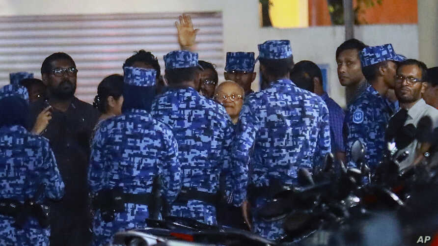 FILE - Policemen arrest former Maldives president and opposition leader Maumoon Abdul Gayoom, center, after the government declared a 15-day state of emergency in Male, Maldives, Feb. 6, 2018.
