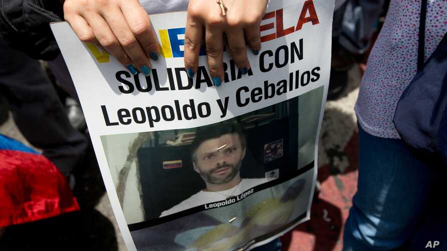 A supporter of jailed opposition leader Leopoldo Lopez holds a poster of him during an anti-government protest in Caracas, Venezuela, May 30, 2015.