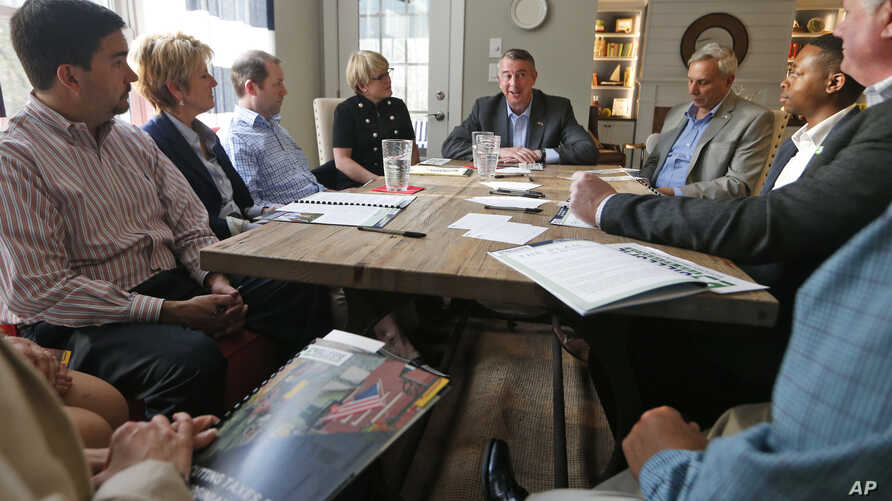 Republican gubernatorial candidate, Ed Gillespie, top center, gestures during a kitchen table discussion at a private home in Toano, Va.,  March 21, 2017. Gillespie faces fellow Republicans, State Sen. Frank Wagner, and Corey Stewart in the June 13th