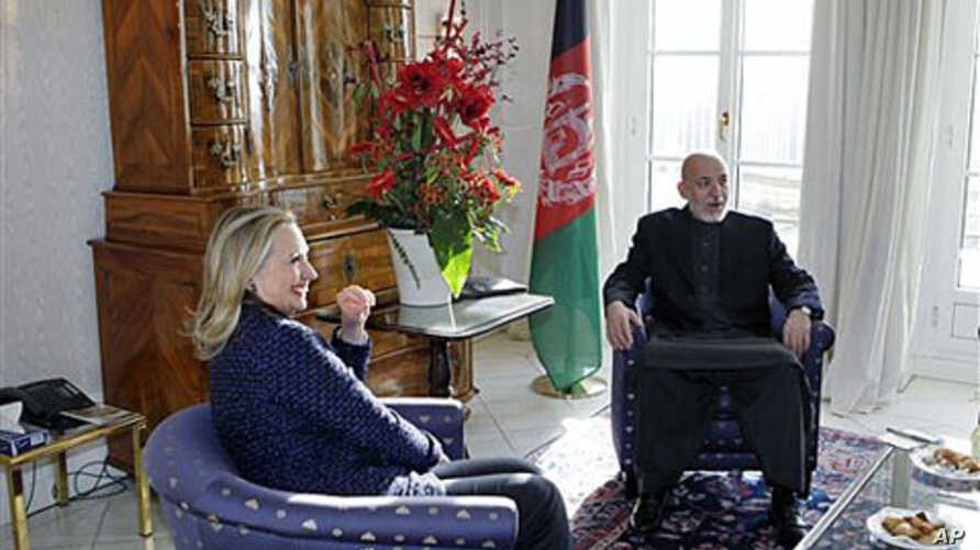 U.S. Secretary of State Hillary Rodham Clinton (L) holds private talks with Afghan President Hamid Karzai during an international conference on the future of Afghanistan, in Bonn, Germany, December 5, 2011.