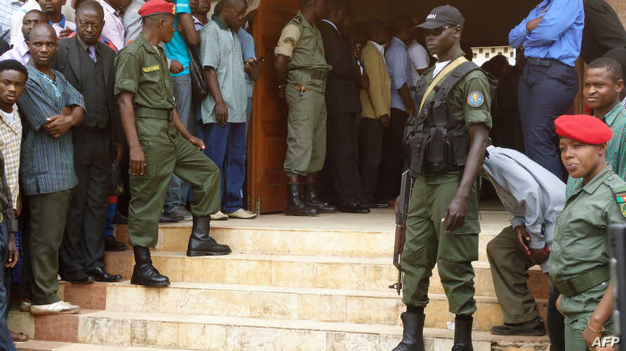 FILE - Police forces stand at the entrance of a courthouse in Yaounde, Cameroon, July 16, 2012. Ten Cameroon separatist leaders extradited from Nigeria made their first court appearance in Yaounde Friday.