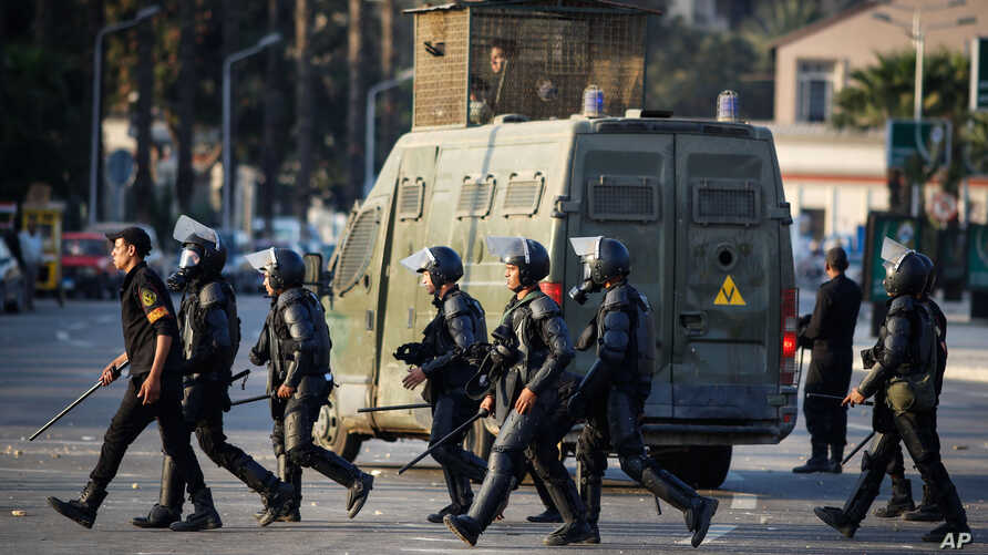 Egyptian riot police move to disperse students and supporters of the country's ousted president after they rallied outside a Cairo university, Thursday, Nov. 28, 2013.