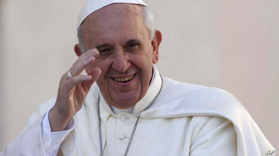 Pope Francis waves as he arrives to lead his Wednesday general audience in Saint Peter's Square at the Vatican, Sept. 18, 2013.
