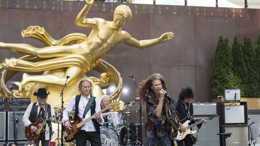 "Aerosmith band members, from left, Brad Whitford, Tom Hamilton, Joey Kramer, Steven Tyler and Joe Perry, perform on NBC's ""Today"" show at Rockefeller Center, Aug. 15, 2018, in New York."