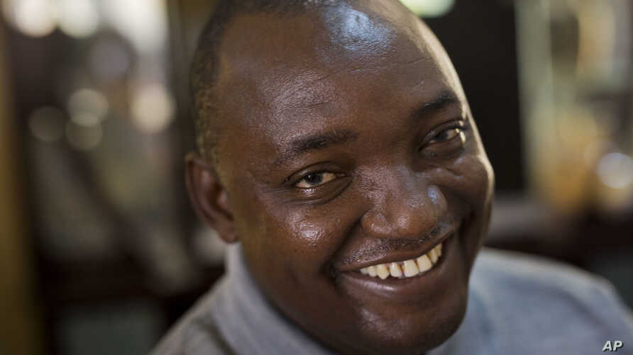 Gambian President-elect Adama Barrow sits for an interview with the Associated Press at his residence in Yundum, Gambia, Dec. 3, 2016.