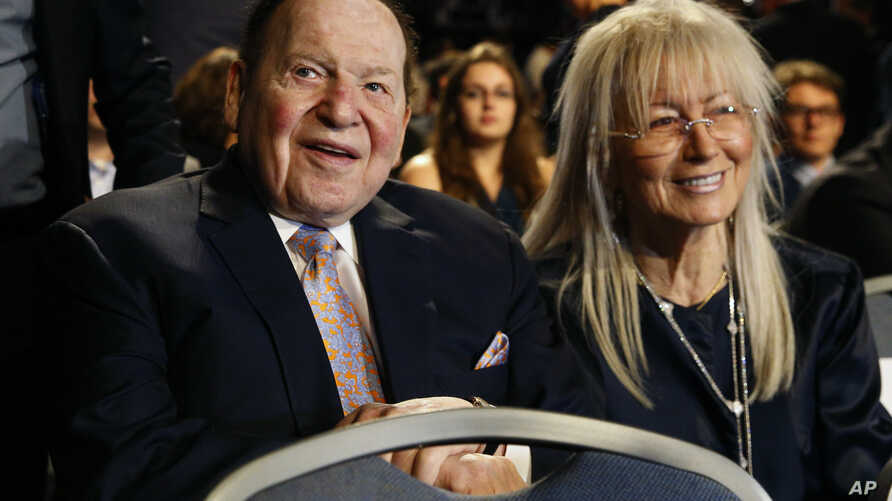 FILE - Chief Executive of Las Vegas Sands Corporation Sheldon Adelson sits with his wife Miriam waits for the presidential debate between Democratic presidential nominee Hillary Clinton and then-Republican presidential nominee Donald Trump at Hofstra