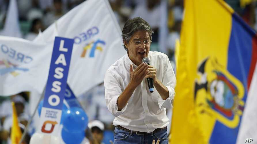 Guillermo Lasso, presidential candidate for the CREO political party, talks to the crowd during his closing campaign event ahead of Sunday's presidential runoff election in Guayaquil, Ecuador, March 30, 2017.