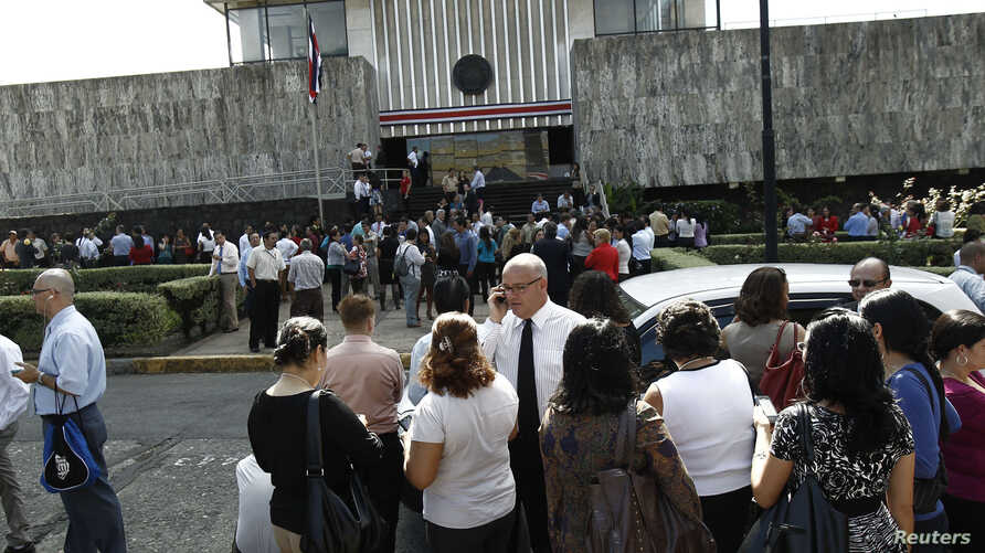 People gather in front of Costa Rica's Supreme Court building, after being evacuated from their respective buildings following a 7.9 magnitude earthquake that shook the region, in San Jose, Costa Rica, September 5, 2012.