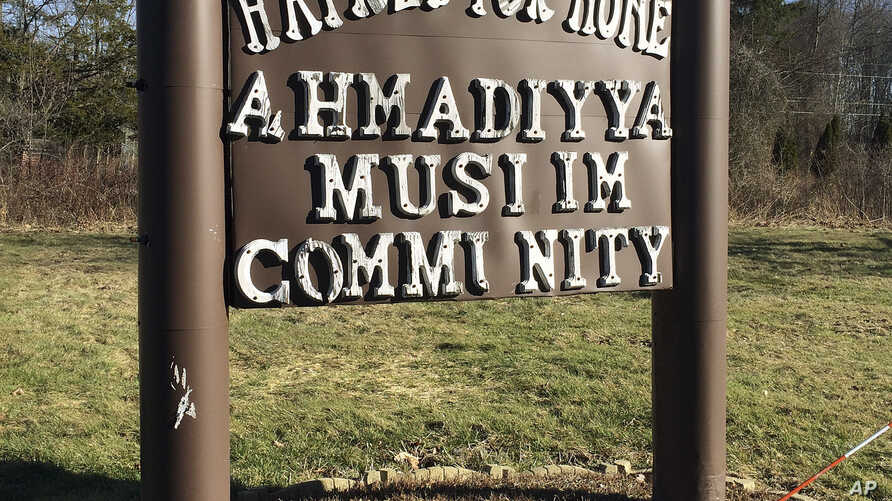 """FILE - A sign bearing the words """"Love for all, hatred for none"""" stands outside a mosque in Meriden, Connecticut, Feb. 27, 2016."""