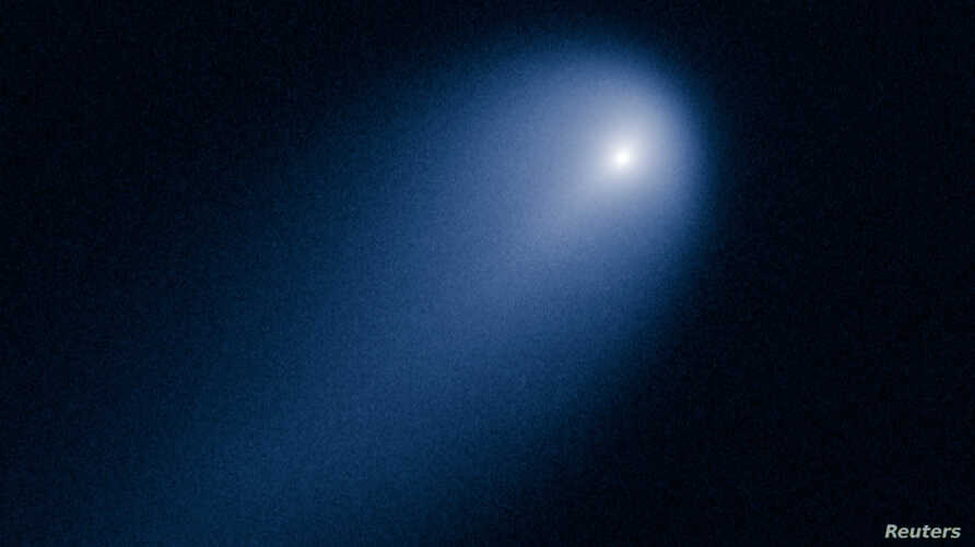 Comet ISON is shown in this NASA handout photographed by the Hubble telescope on April 10, 2013.