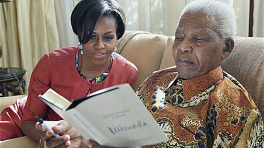 US first lady Michelle Obama (L) with former South African President Nelson Mandela, at this home, in Houghton, South Africa, June 21, 2011