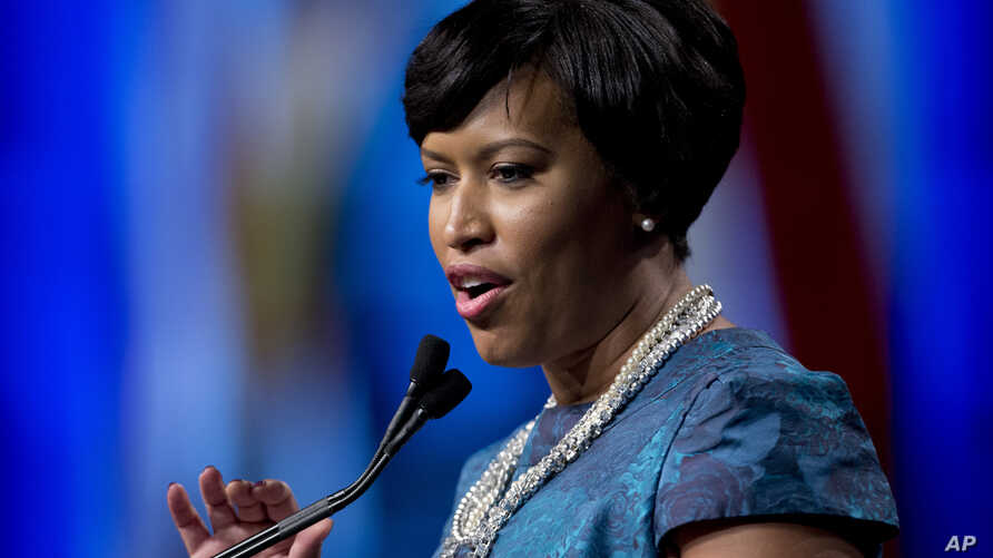 FILE - Washington Mayor Muriel Bowser, shown after taking the oath of office last month, defied a lawmaker's threat that she and other city leaders could face prison time for implementing a voter-approvedmarijuana law.