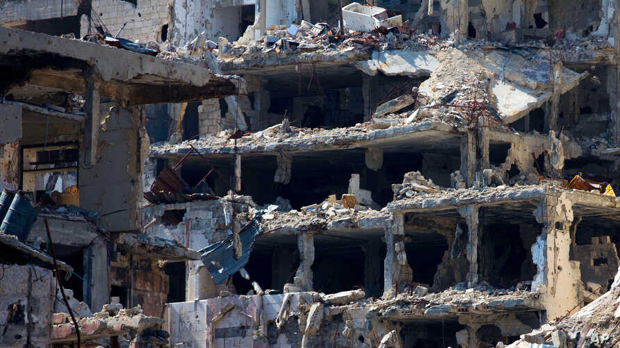 destroyed buildings are seen in the old city of Homs, Syria, Feb. 26, 2016.