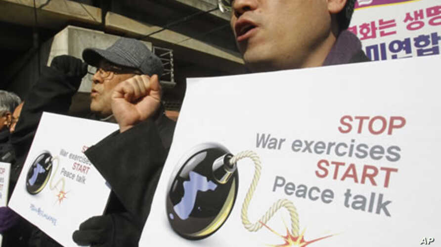 South Korean protesters shout slogans during a rally against the annual joint military exercises between South Korea and the United States, in front of the Yongsan U.S. Army headquarters in Seoul, South Korea, February 27, 2012.
