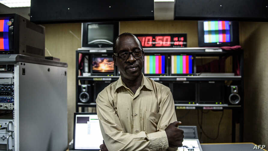 Television director of Burundi's National Radio and Television, Nestor Bankumukunzi, poses in the studio in Bujumbura on May 15,2015.