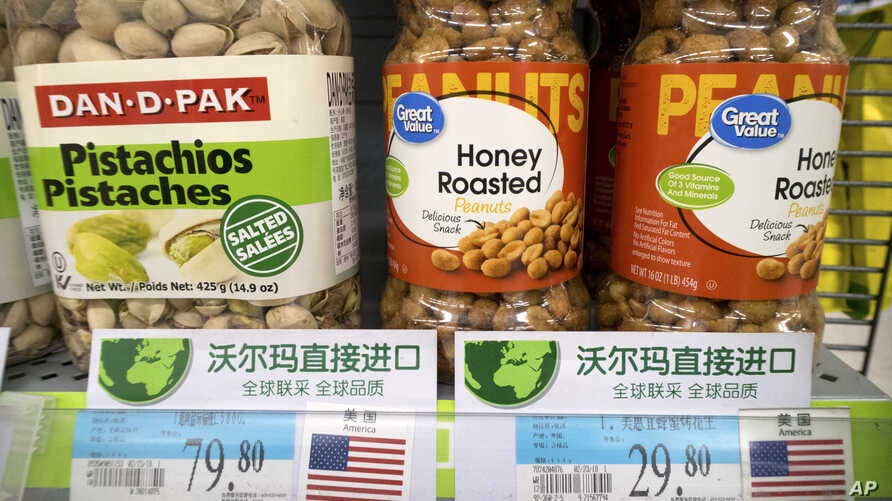 Imported nuts from the United States are displayed at a supermarket in Beijing, March 23, 2018. China announced a $3 billion list of U.S. goods including pork, apples and steel pipe on Friday that it said may be hit with higher tariffs.