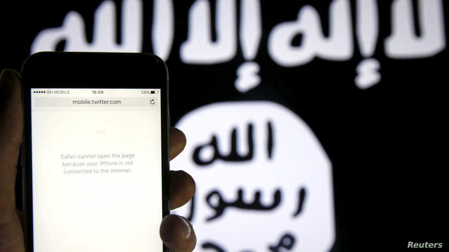 FILE - An unloaded Twitter website is seen on a phone without an internet connection, in front of a displayed ISIS flag in this photo illustration in Zenica, Bosnia and Herzegovina.