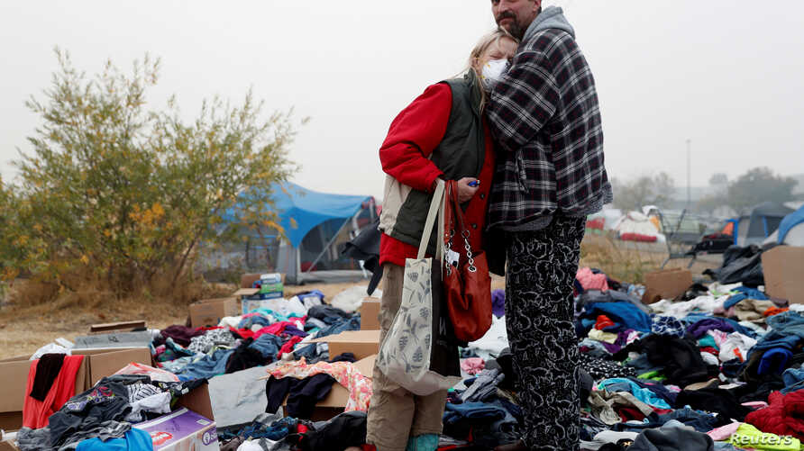 Travis Lee Hogan, of Paradise, comforts his mother, Bridgett Hogan, while they stay at a makeshift evacuation center for people displaced by the Camp Fire in Chico, California, U.S., November 15, 2018.