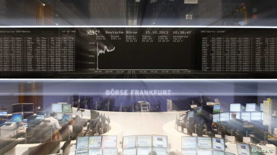 The German share price index DAX board is pictured shortly after the curve reached a new all-time high at the stock exchange in Frankfurt, Oct. 15, 2013.