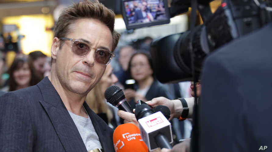 Robert Downey Jr. is interviewed upon arrival at the premiere for the film 'The Avengers Age of Ultron' in London, April, 21, 2015.