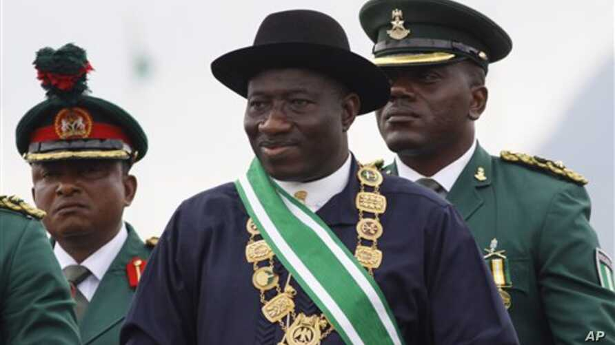 Nigerian President Goodluck Jonathan, center, inspects a guard of honor during his inauguration ceremony at the main parade ground in Nigeria's capital of Abuja. Jonathan was sworn in Sunday for a full four-year term as president of Nigeria, May 29,