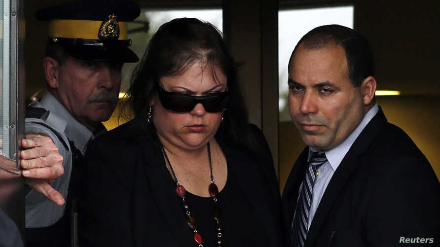 Algerian citizen Mohamed Harkat (R) and his wife Sophie (C) leave the Supreme Court of Canada in Ottawa, May 14, 2014.
