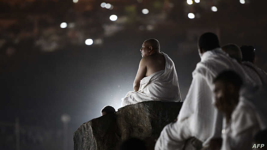 Muslim pilgrims gather on Mount Arafat near Mecca as they perform one of the Hajj rituals late on Oct. 3, 2014.