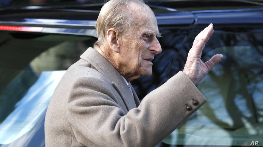 FILE - Britain's Prince Philip waves to the public as he leaves after attending a Christmas day church service in Sandringham, England, Dec. 25, 2016.