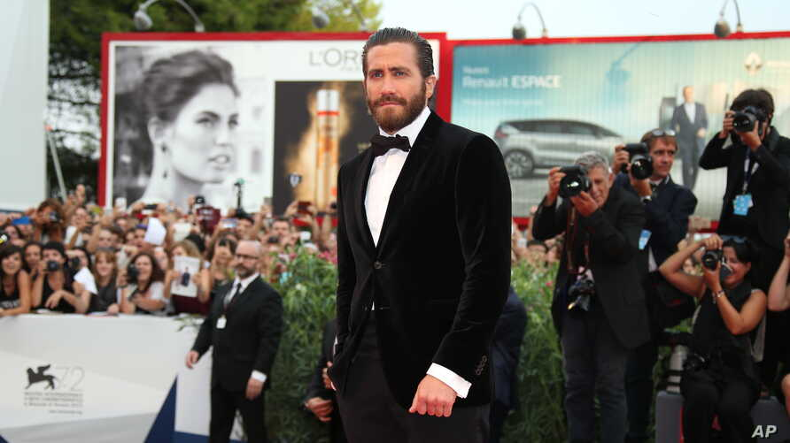 Jake Gyllenhaal poses for photographers upon the red carpet of the film Everest and the opening ceremony of the 72nd edition of the Venice Film Festival in Venice, Italy, Sept. 2, 2015.