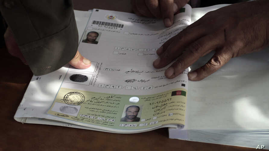 An Afghan man marks his application for voter registration with his fingerprint for identification purposes at a voter registration center in Kabul, Afghanistan, Monday, Sept. 16, 2013. Afghanistan's presidential race kicked off Monday as election au