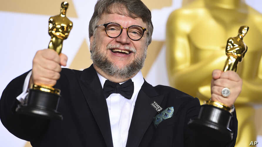 """Guillermo del Toro, winner of the awards for best director and best picture for """"The Shape of Water,"""" poses in the press room at the Oscars, March 4, 2018, at the Dolby Theatre in Los Angeles."""