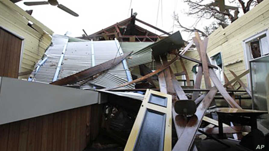 A library in the small community of Cardwell, Australia, is without a roof and badly damaged after Cyclone Yasi brought heavy rain and howling winds, February 4, 2011