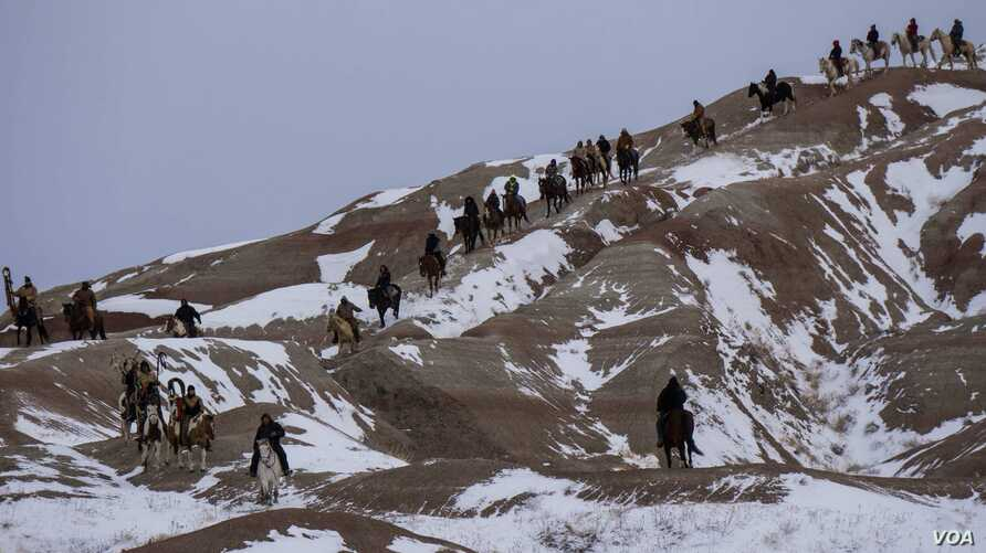 Big Foot Memorial Riders crossing through the South Dakota Badlands en route to the site of the 1890 Wounded Knee massacre, December 29, 2017.  Photo: Charmaine Juban-Salgado
