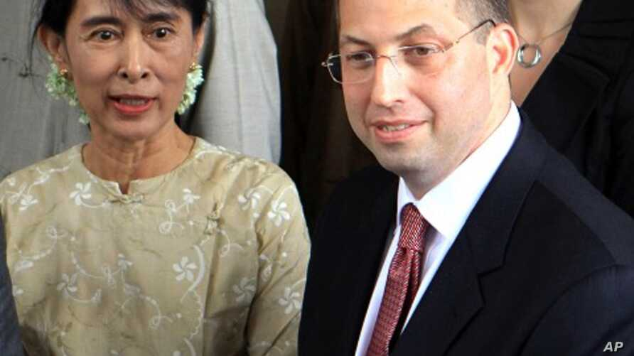 Pro-democracy leader Aung San Suu Kyi, left, sees off Derek Mitchell, right, Washington's special representative to Burma, after their meeting at her home in Rangoon, Sept ember 12, 2011.