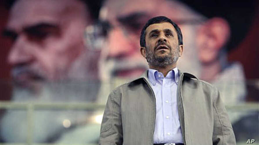 In front of portraits of the late Iranian revolutionary founder Ayatollah Khomeini (L) and supreme leader Ayatollah Ali Khamenei, President Mahmoud Ahmadinejad joins a ceremony commemorating International Day Against Drug Abuse, at the Azadi [Freedom