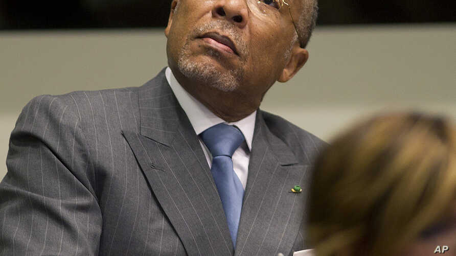Former Liberian President Charles Taylor looks up to the public gallery as he waits for the start of his sentencing hearing in Leidschendam, near The Hague, Netherlands, May 16, 2012