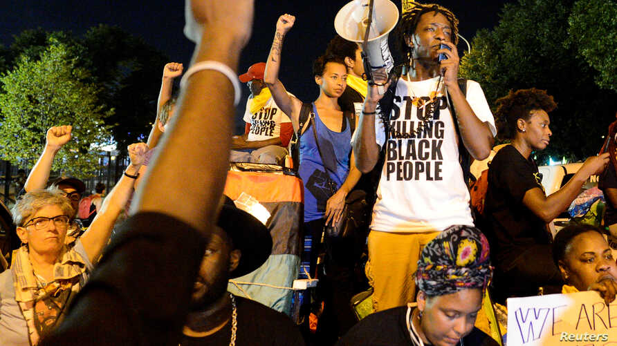 A Black Lives Matter protester addresses fellow protesters near the site of Democratic National Convention in Philadelphia, Pennsylvania, U.S., July 26, 2016.