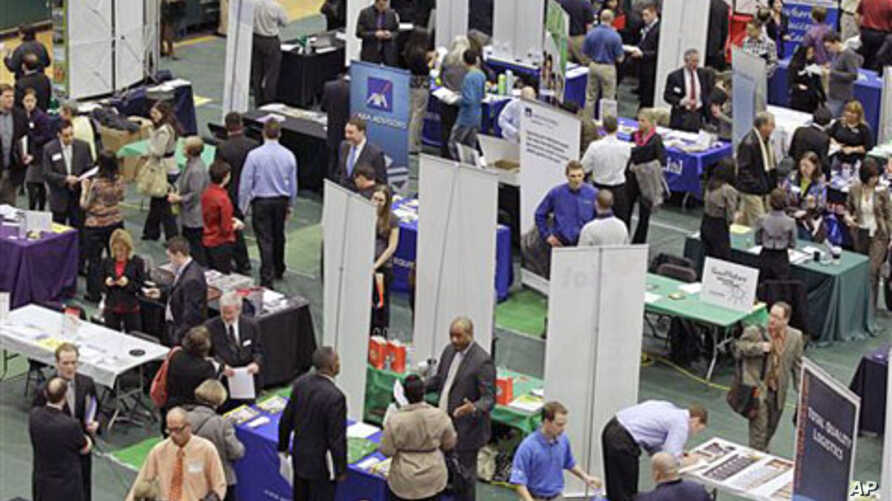 Job seekers pack the aisles of the 32nd Annual Spring Career Fair at Cleveland State University on a day when the jobless report showed employers hired in February at the fastest pace in almost a year, and the unemployment rate fell to 8.9 percent, M