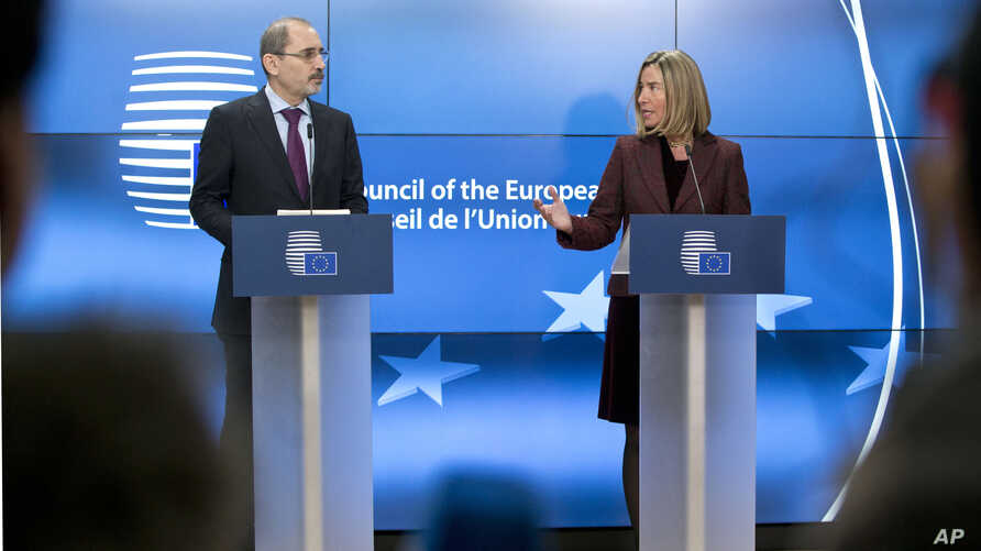 European Union foreign policy chief Federica Mogherini, right, and Jordan's Foreign Minister Ayman Safadi participate in a media conference after a meeting of EU foreign ministers at the Europa building in Brussels, Feb. 26, 2018.