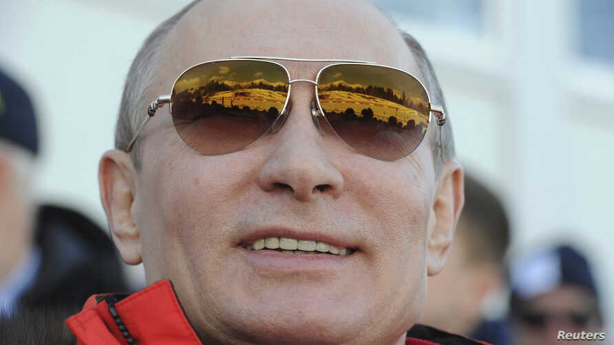 Russian President Vladimir Putin watches the cross country skiing men's relay during the Olympic Winter Games in Sochi Feb. 16, 2014.