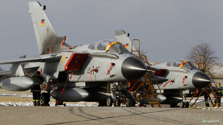 """FILE - Tornado fighter jets planes of the reconnaissance squadron 51 """"Immelmann"""" stand on the runway upon arrival at Schleswig airbase in Jagel, near the German-Danish border."""