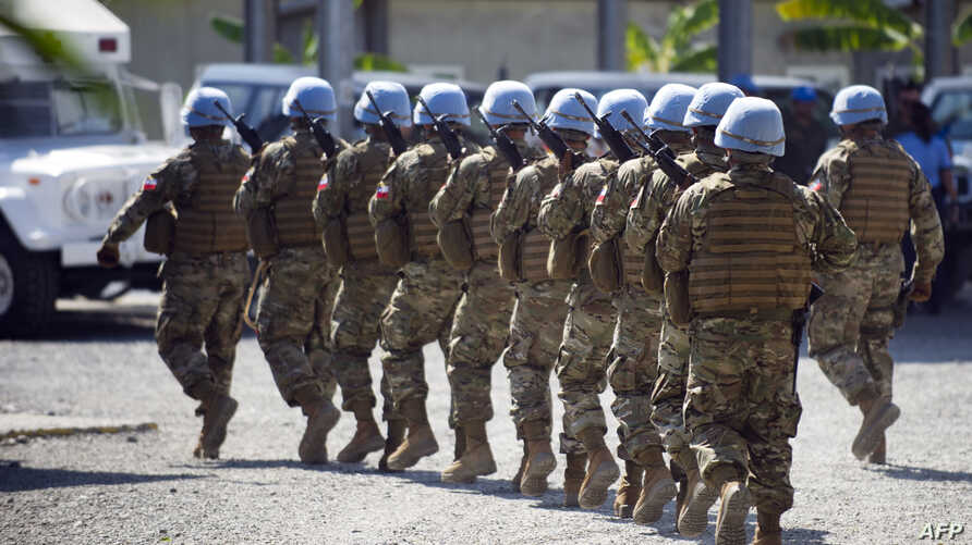FILE - Chilean soldiers, part of the United Nations Stabilization Mission in Haiti (MINUSTAH) march after giving honors to President of U.N. Security Council Cristian Barros during the visit of representatives of the United Nations Security Council,